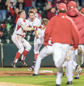 Arkansas catcher Carson Shaddy (20) celebrates with Arkansas outfielder Luke Bonfield (17) after Luke Bonfield got a RBI walk-off hit during a baseball game between Arkansas and Auburn on 3-25-16.  (Alan Jamison, Nate Allen Sports Service)