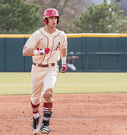 Arkansas outfielder Luke Bonfield (17) circles the bases for his first career home run (3 RBI's) during a baseball game between Arkansas and Central Michigan on 2-21-16.   (Alan Jamison, Nate Allen Sports Service)