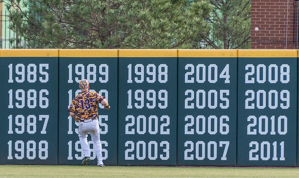 Central Michigan outfielder Logan Regnier (13) watches as a home run hit by Arkansas outfielder Luke Bonfield (17) goes over the fence near the 400 yard marker during a baseball game between Arkansas and Central Michigan on 2-21-16.   (Alan Jamison, Nate Allen Sports Service)