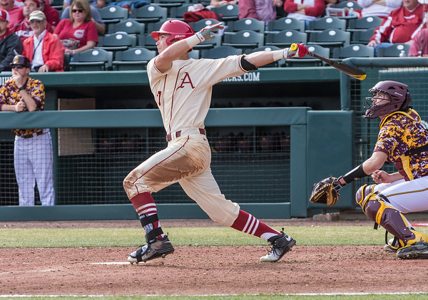 Arkansas outfielder Luke Bonfield (17) hits a three-run homer during a baseball game between Arkansas and Central Michigan on 2-21-16.   (Alan Jamison, Nate Allen Sports Service)