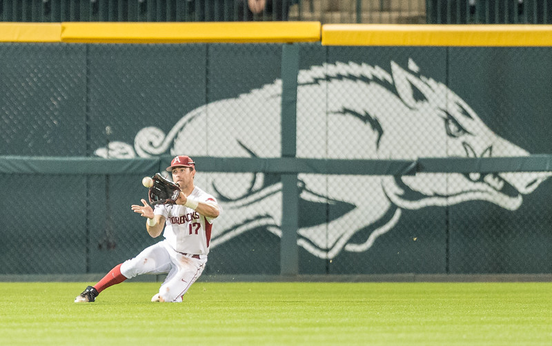 Arkansas outfielder Luke Bonfield (17) with a nice defensive play during a baseball game between Arkansas and Grambling State on 3-15-2016.    (Alan Jamison, Nate Allen Sports Service)