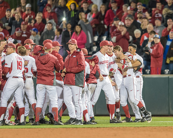 Arkansas infielder Michael Bernal (3) huts Luke Bonfield after Bonfield's walk-off base hit during a baseball game between Arkansas and Auburn on 3-25-16.  (Alan Jamison, Nate Allen Sports Service)