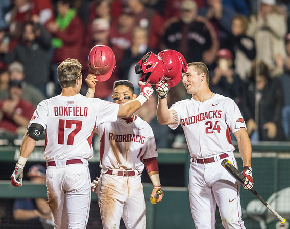 Arkansas outfielder Luke Bonfield (17) celebrates a home run with Rick Nomura and Chad Spanberger during a baseball game between Arkansas and Auburn on 3-26-16.  (Alan Jamison, Nate Allen Sports Service)
