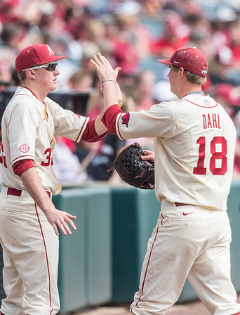 Arkansas pitcher Zach Jackson (32) congratulates Anthony Dahl after his pitching performance during a baseball game between Arkansas and Central Michigan on 2-21-16.   (Alan Jamison, Nate Allen Sports Service)