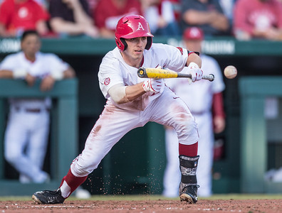 Arkansas catcher Carson Shaddy (20) bunts during a baseball game between Arkansas and Central Michigan on 2-19-16.   (Alan Jamison, Nate Allen Sports Service)