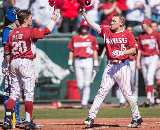 Arkansas catcher Carson Shaddy (20) congratulates Jake Arledge on his home run during a baseball game between Arkansas and Eastern Illinois on 3-5-16.   (Alan Jamison, Nate Allen Sports Service)