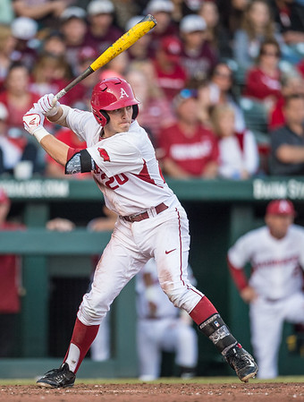 Arkansas catcher Carson Shaddy (20) bots during a baseball game between Arkansas and Central Michigan on 2-19-16.   (Alan Jamison, Nate Allen Sports Service)