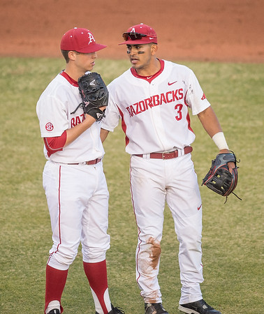 Arkansas infielder Michael Bernal (3) visits Arkansas pitcher Kacey Murphy (21) on the mound during a baseball game between Arkansas and Central Michigan on 2-19-16.   (Alan Jamison, Nate Allen Sports Service)