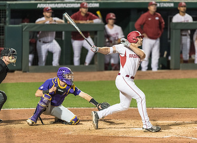 Arkansas catcher Chad Spanberger (24) hits a deep ball during a baseball game between Arkansas and LSU on Friday, 4/7/2017.  (Alan Jamison, Nate Allen Sports Service)