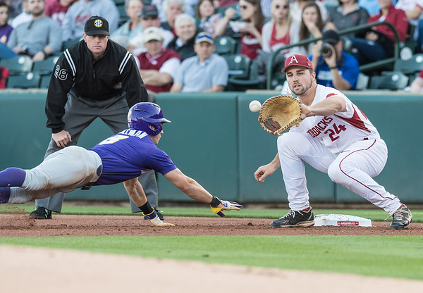 Arkansas catcher Chad Spanberger (24) attempts a tag during a baseball game between Arkansas and LSU on Friday, 4/7/2017.  (Alan Jamison, Nate Allen Sports Service)
