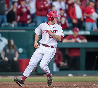Arkansas outfielder Jack Benninghoff (26) scores during a baseball game between Arkansas and Central Michigan on 2-19-16.   (Alan Jamison, Nate Allen Sports Service)