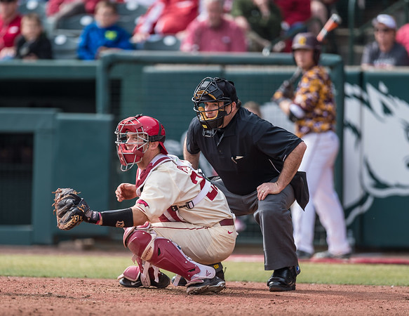 Arkansas catcher Tucker Pennell (27) and the umpire watch a ball go foul during a baseball game between Arkansas and Central Michigan on 2-21-16.   (Alan Jamison, Nate Allen Sports Service)