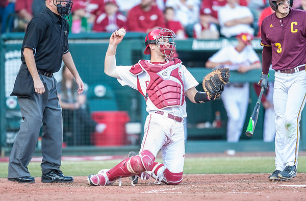 Arkansas catcher Tucker Pennell (27) throws the ball back to the pitcher during a baseball game between Arkansas and Central Michigan on 2-19-16.   (Alan Jamison, Nate Allen Sports Service)