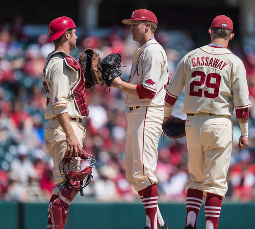 Arkansas catcher Tucker Pennell (27) welcomes relief pitcher Zach Jackson to the mound during a baseball game between Arkansas and Missouri on 4-3-16.  (Alan Jamison, Nate Allen Sports Service)