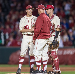 Arkansas hitting coach Dave Jorn visits James Teague on the mound during a baseball game between Arkansas and Florida on 4/16/2016.   (Alan Jamison, Nate Allen Sports Service)