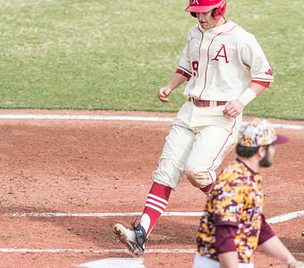 Arkansas infielder Cullen Gassaway (29) scores a run during a baseball game between Arkansas and Central Michigan on 2-21-16.   (Alan Jamison, Nate Allen Sports Service)