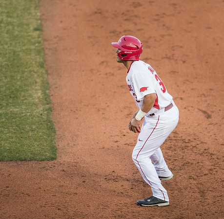 Arkansas infielder Michael Bernal (3) leans toward second base during a baseball game between Arkansas and Central Michigan on 2-19-16.   (Alan Jamison, Nate Allen Sports Service)
