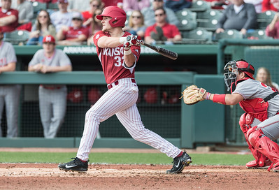 Arkansas catcher Grant Koch (33) hits during a baseball game between Arkansas and Miami (Ohio) on Saturday. 2/18/2017.  (Alan Jamison, Nate Allen Sports Service)
