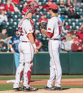 Arkansas pitcher Blaine Knight (16) confers with Arkansas catcher Grant Koch (33) on the mound during a baseball game between Arkansas and Rhode Island on Friday, 3/10/2017.  (Alan Jamison, Nate Allen Sports Service)