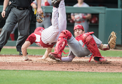 Arkansas catcher Grant Koch (33) dives over Miami (Ohio) catcher Spencer Dull (20) to score during a baseball game between Arkansas and Miami (Ohio) on Saturday. 2/18/2017.  (Alan Jamison, Nate Allen Sports Service)