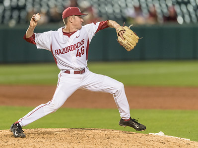 Arkansas pitcher Barrett Loseke (46) attempts a pick off at second base during a baseball game between Arkansas and Texas A&M University on 4/30/2016.   (Alan Jamison, Nate Allen Sports Service)