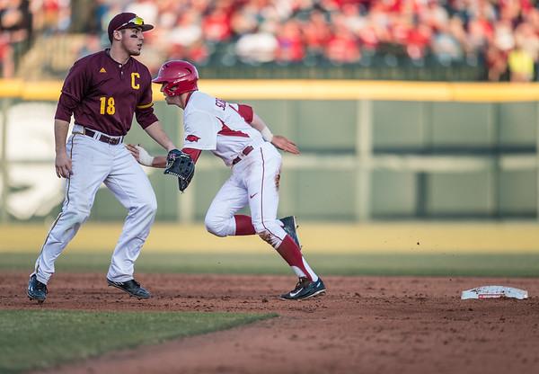 Arkansas infielder Cody Scroggins (5) heads to third base during a baseball game between Arkansas and Central Michigan on 2-19-16.   (Alan Jamison, Nate Allen Sports Service)