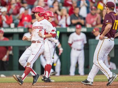 Arkansas infielder Cody Scroggins (5) scores his first collegiate run during a baseball game between Arkansas and Central Michigan on 2-19-16.   (Alan Jamison, Nate Allen Sports Service)