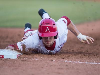 Arkansas infielder Cody Scroggins (5) returns to first base during a baseball game between Arkansas and Central Michigan on 2-19-16.   (Alan Jamison, Nate Allen Sports Service)