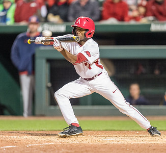 Arkansas outfielder Darien Simms (7) squares to bunt during a baseball game between Arkansas and Auburn on 3-25-16.  (Alan Jamison, Nate Allen Sports Service)