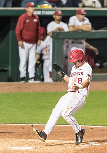 Arkansas outfielder Eric Cole (8) scores a run during a baseball game between Arkansas and LSU on Friday, 4/7/2017.  (Alan Jamison, Nate Allen Sports Service)
