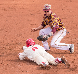 Arkansas outfielder Eric Cole (8) is tagged out at second base by Central Michigan infielder Zach McKinstry (8) during a baseball game between Arkansas and Central Michigan on 2-21-16.   (Alan Jamison, Nate Allen Sports Service)