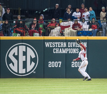 Arkansas outfielder Clark Eagan (9) catches a fly ball during a baseball game between Arkansas and Missouri on 4-1-16.  (Alan Jamison, Nate Allen Sports Service)