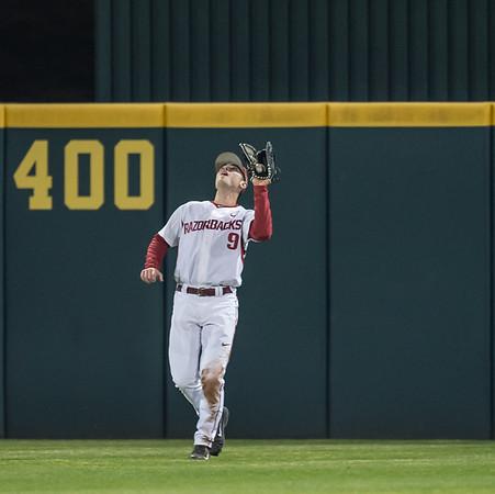 Arkansas outfielder Clark Eagan (9) catches a fly ball during a baseball game between Arkansas and Missouri on 4-1-16.  (Alan Jamison, Nate Allen Sports Service)