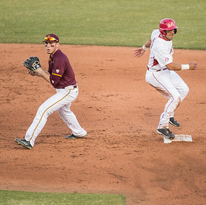 Arkansas infielder Michael Bernal (3) is safe at second as CMU shortstop looks to first base during a baseball game between Arkansas and Central Michigan on 2-19-16.   (Alan Jamison, Nate Allen Sports Service)