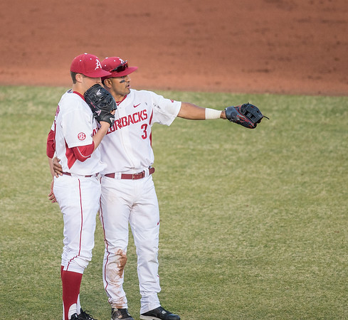 Arkansas infielder Michael Bernal (3) talks to Kacey Murphy on the mound during a baseball game between Arkansas and Central Michigan on 2-19-16.   (Alan Jamison, Nate Allen Sports Service)