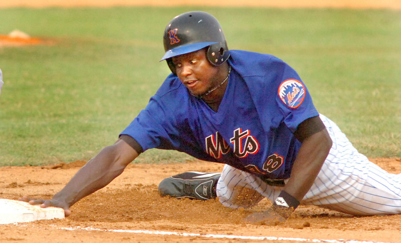 #48 for K-Mets dives back into first base. Photo by ned Jilton II