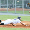 Kingsport Mets #13 slides back into first base as Greeneville #30 attempts to catch the ball. Photo by Erica Yoon