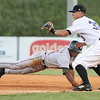 Greeneville Astros #25 runs back to first base as Kingsport Mets #33 waits for the ball. Photo by Erica Yoon