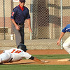 #18 for Honaker beats the throw to first being fielded by #11 of Gate City. Photo by Ned Jilton II