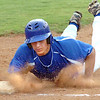 Gate City's Trey Clark, #7, dives back into first. Photo by Ned Jilton II