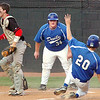 Gate City's Aaron Stokes, #34, yells at teammate Nick Bright, #20 to hit the dirt at the plate while James River catcher Ryan Hepler, #25, waits for the throw. Photo by ned Jilton II