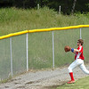 #9 for Twin Springs reaches the warning track as the ball (upper left corner) sails over the fence for a home run by Coeburn's #25. Photo by Ned Jilton II