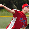 Twin Springs starting pitcher, #2, delivers pitch to plate. Photo by Ned Jilton II