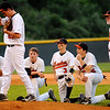 Honaker infielders and coach Tom Harding watch as relief pitcher Cory Brown warms up during Thursday's semifinal game against Virginia High in Coeburn. Photo by Kris Wilson - kswilson@timesnews.net