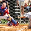 Twin Springs catcher reaches to make the tag, too late, on a sliding #7 of Coeburn who breaks a scoreless tie. Photo by Ned Jilton II