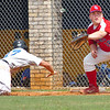 #17 of Coeburn dives safely back into first as #18 for Twin Springs fields the throw. Photo by Ned Jilton II