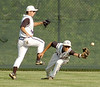 St. Paul's  left fielder #14, David Grizzel, jumps over center fielder #7, Bryce Lawson, as Lawson dives to attempt the catch. Photo by Ned Jilton II