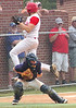 #21 for JJ Kelly jumps over the Grayson Blue Devil catcher and scores as the catcher fields a low throw. Photo by Ned Jilton II