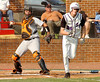 Burton catcher J. Hunnicutt attempts to throw out St Pauls #24 Matt Dupuie who bunted to advance the runners. Photo by Ned Jilton II