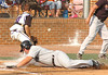 Burton's #15, J. Coffey, slides head first across home plate with the go ahead run as St. Paul's #21 David Kiser, the catcher scrambes after wild throw to the plate. Photo by Ned JIlton II